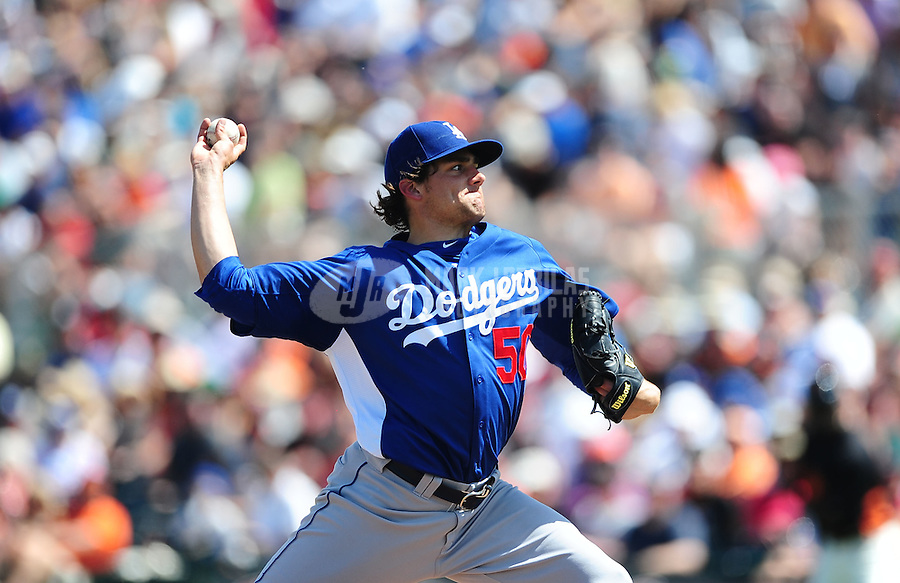 Mar. 28, 2012; Scottsdale, AZ, USA; Los Angeles Dodgers pitcher Nathan Eovaldi pitches in the second inning against the San Francisco Giants at Scottsdale Stadium.  Mandatory Credit: Mark J. Rebilas-