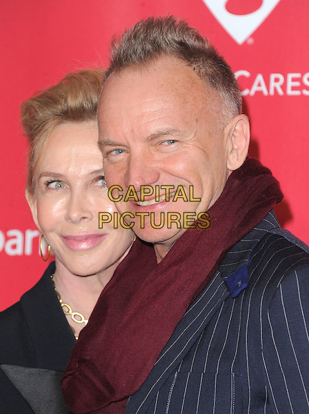 Trudie Styler & Sting (Gordon Sumner).The MusiCares 2013 Person Of The Year Tribute held at The Los Angeles Convention Center, West Hall in Los Angeles, California, USA..February 8th, 2013.headshot portrait black jacket blazer husband wife married red burgundy scarf navy blue pinstripe jacket .CAP/RKE/DVS.©DVS/RockinExposures/Capital Pictures.