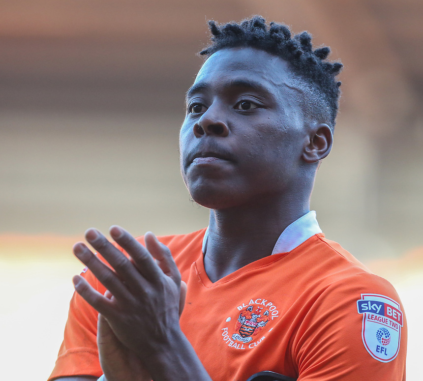 Blackpool's Bright Osayi-Samuel celebrates with fans after the final whistle<br /> <br /> Photographer Alex Dodd/CameraSport<br /> <br /> The EFL Sky Bet League Two - Blackpool v Hartlepool United - Saturday 25th March 2017 - Bloomfield Road - Blackpool<br /> <br /> World Copyright &copy; 2017 CameraSport. All rights reserved. 43 Linden Ave. Countesthorpe. Leicester. England. LE8 5PG - Tel: +44 (0) 116 277 4147 - admin@camerasport.com - www.camerasport.com