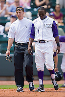 Justin Greene #1 of the Winston-Salem Dash is helped off the field by trainer Josh Fallin after being struck in the helmet with a fastball at the BB&T Park April25, 2010, in Winston-Salem, North Carolina.  Photo by Brian Westerholt / Four Seam Images