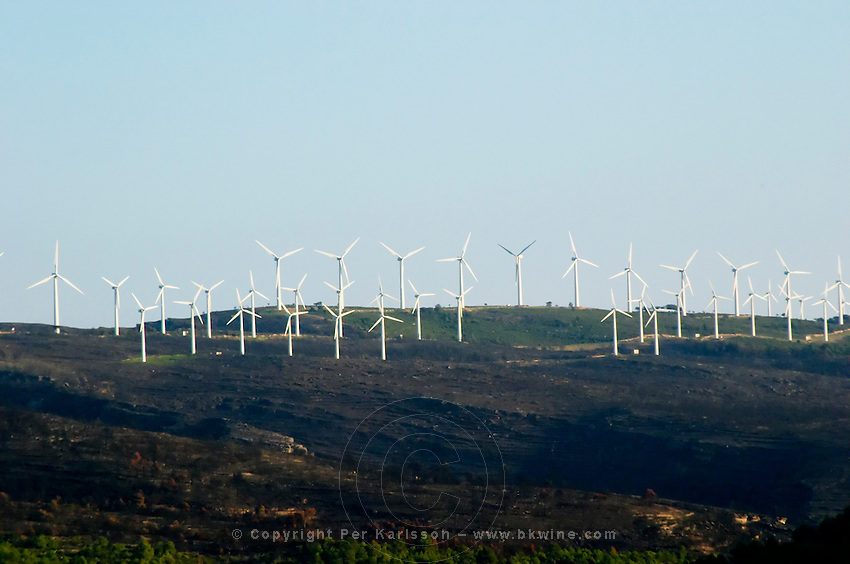 Wind farm on hilltop with wind power turbines. Priorato, Catalonia, Spain