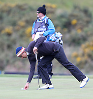 Thursday 28 May 2015; Matteo Manassero, Italy, marks his ball on the 13th green<br /> <br /> Dubai Duty Free Irish Open Golf Championship 2015, Round 1 County Down Golf Club, Co. Down. Picture credit: John Dickson / SPORTSFILE