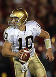 Los Angeles, CA 11/25/06 - Notre Dame's Brady Quinn rolls out of the pocket during the second quarter of play against USC in the Los Angeles Memorial Colliseum<br />