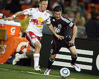 Chris Pontious (13) of D.C. United holds up Jan Gunnar Solli (8) of the New York Red Bulls during an MLS match at RFK Stadium, in Washington D.C. on April 21 2011. Red Bulls won 4-0.