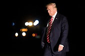 US President Donald J. Trump walks to the residence after stepping off Marine One on the South Lawn of the White House in Washington, DC, USA, 07 October 2017. President Trump traveled to  North Carolina for a pair of fund raising events<br /> Credit: Shawn Thew / Pool via CNP