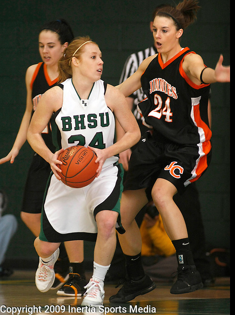 SPEARFISH, SD - FEBRUARY 25, 2009 --  Katelynn Lamb #24 of Black Hills State looks past Jamestown College defender Ali Edwards during their Dakota Athletic Conference semi-final game Wednesday evening at the Young Center.  (Photo by Dick Carlson/Inertia)