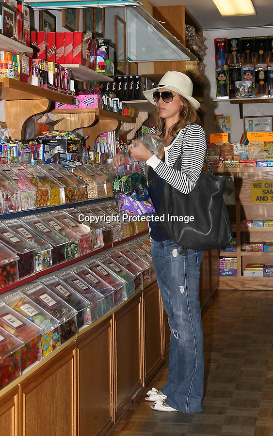 4-24-09.Jessica Alba shopping for candy at store called The Candy Baron in Santa Monica ca. Jessica was illegally parked behind the store and the officer wrote her up a ticket..AbilityFilms@yahoo.com.805-427-3519.www.AbilityFilms.com