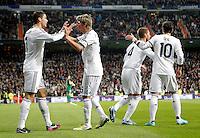 Real Madrid's Cristiano Ronaldo celebrates with Fabio Coentrao, Sergio Ramos and Mesut Özil during La Liga Match. December 01, 2012. (ALTERPHOTOS/Alvaro Hernandez)