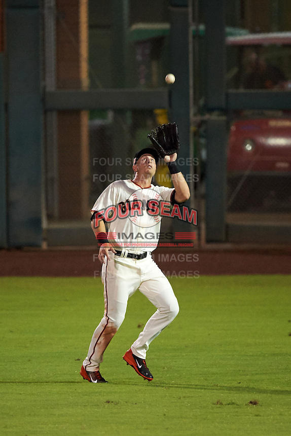 Scottsdale Scorpions outfielder Austin Slater (23) catches a fly ball during an Arizona Fall League game against the Salt River Rafters on October 14, 2015 at Scottsdale Stadium in Scottsdale, Arizona.  Scottsdale defeated Salt River 13-3.  (Mike Janes/Four Seam Images)
