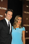 """Passions Natalie Zea """"Gwen Hotchkiss"""" poses with partner Passions Travis Schuldt as she stars as """"Clare Matthews"""" and wearing Jenni Kayne dress in """"The Following"""", Fox's new tv series on Mondays, which held its world premiere on January 19, 2013 at the New York Public Library, New York City, New York. (Photo by Sue Coflin/Max Photos)"""