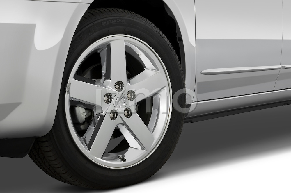 Tire and wheel close up detail view of a 2008 Dodge Avenger RT