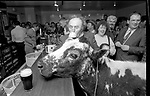 1992 The Blackwater Taverm (owner Teddy O'Neill) Direendraugh, Blackwater, Sneem, County Kerry Ireland 1992:  The Gay Byrne Radio Show, (Ireland's most listened to show) celebrated 'Big Bertha', reaching 48 years of age and appearing in the Guinness Book of Records as the world's oldest cow. In this photograph show  owner Farmer Jerome O'Leary celebrates in  the pub as the party is broadcast live on air in 1992. Bertha left her 'mark' on the floor during the transmission.<br /> Big Bertha died on New Year's Eve 1993.<br /> Photo: Don MacMonagle <br /> e: info@macmonagle.com