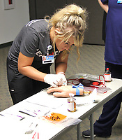 Photo Submitted Freeman Nurse Resident Meaghan Lester performs a blood draw during the Registered Nurse (RN) Residency Program induction ceremony Friday, June 21, at Freeman Hospital East. The one-year interactive program is designed for newly graduated nurses to help them transition from student nurse to a professional role. This evidence-based program focuses on patient outcomes, leadership, professional roles and unit-specific education. Units participating include: Cardiology, Intensive Care, Cardiac/Medical, Transitional Care, Medical, Ortho/Neuro and General Surgery. The program is in its second year and is conducted by the Freeman Professional Development department.