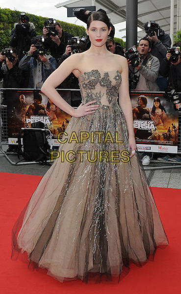 "GEMMA ARTERTON.wearing Valentino .At the World Film Premiere of ""Prince of Persia: The Sands Of Time"", Vue cinema at Westfield shopping centre, London, England, 9th May 2010..arrivals full length strapless beige nude dress gown long maxi tulle layered silver  beaded grey gray hand on hip .CAP/CAN.©Can Nguyen/Capital Pictures."