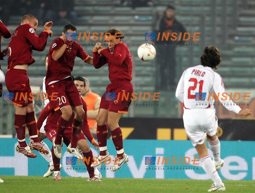 CAlcio di punizione di Pirlo respinto dalla barriera della Roma composta da De Rossi Perrotta e Taddei<br /> Italy &quot;Tim Cup&quot; 2006-2007<br /> 31 Jan 2007 (Semifinal 2nd leg)<br /> Roma-Milan (3-1)<br /> &quot;Olimpico&quot; Stadium-Roma-Italy<br /> Photographer:Andrea Staccioli INSIDE