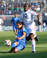 El Salvador's Victor Turcios clears the ball while being pressures by Cuba's Roberto Linares.  El Salvador defeated Cuba 6-1 at the 2011 CONCACAF Gold Cup at Soldier Field in Chicago, IL on June 12, 2011.