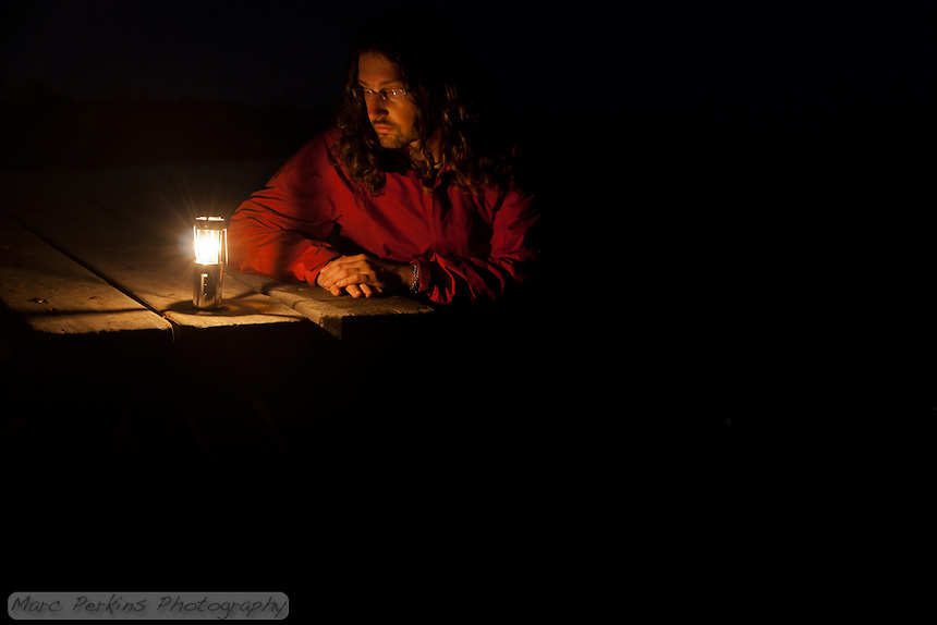 "A good friend who moved away last year gave me this windproof candle housing for backpacking (an UCO Candle Lantern).  While experimenting with night photography on a foggy night at the Lower Moro Campground at Crystal Cove I captured this picture of myself.  I call it, ""Thinking of you""."
