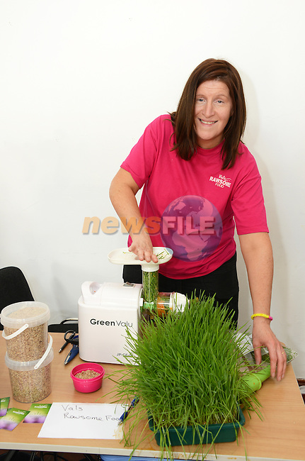 Valerie Faulkner juicing wheatgrass at the mid summer solstice fair at Sonairte. www.newsfile.ie
