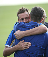 Ian Poulter (Team Europe) gets a hug from Justin Rose (Team Europe) during Sunday's Singles, at the Ryder Cup, Le Golf National, Île-de-France, France. 30/09/2018.<br /> Picture David Lloyd / Golffile.ie<br /> <br /> All photo usage must carry mandatory copyright credit (© Golffile | David Lloyd)