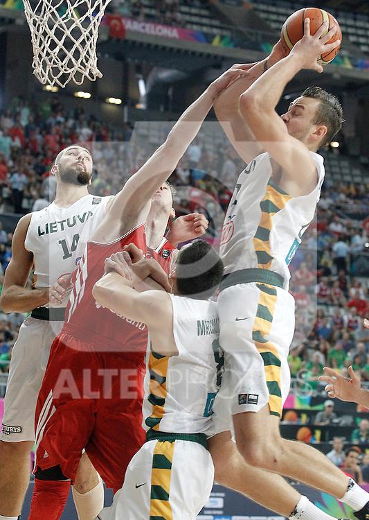 Lithuania's Jonas Valanciunas (l), Jonas Maciulis (c-r) and Donatas Motiejunas (r) and Turkey's Omer Asik during 2014 FIBA Basketball World Cup Quarter-Finals match.September 9,2014.(ALTERPHOTOS/Acero)