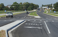 NWA Democrat-Gazette/ANDY SHUPE<br /> Traffic flows Wednesday, Sept. 23, 2015, along Van Asche Drive after the official opening of the nearly 1-mile stretch of roadway between Gregg Avenue and Arkansas 112. The $4.6 million project was completed by APAC-Central.