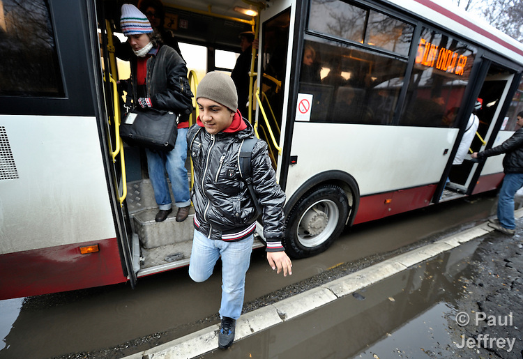Bajram Kruezi alights from a city bus on his way to the Branko Pesic School, an educational center for Roma children and families in Belgrade, Serbia, which is supported by Church World Service. Kruezi's family came to Belgrade as refugees from Kosovo, and like many Roma can't afford regular school fees. Many Roma also lack legal status in Serbia, and thus have difficulty obtaining formal employment and accessing government services. Kruezi wants to be a Muslim religious scholar when he grows up.