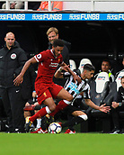 1st October 2017, St James Park, Newcastle upon Tyne, England; EPL Premier League football, Newcastle United versus Liverpool; Joe Gomez of Liverpool tackles Ayoze Perez of Newcastle United with Jurgen Klopp Manager of Liverpool looking on