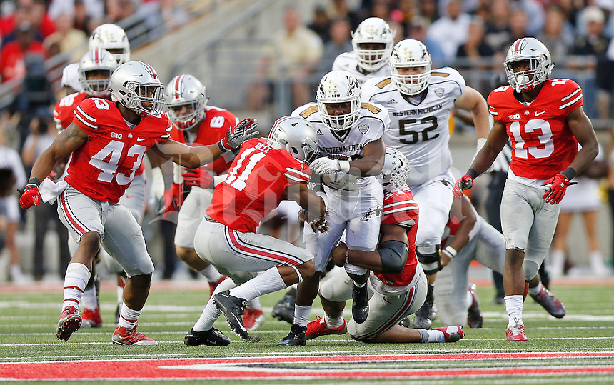 Ohio State Buckeyes safety Vonn Bell (11) and Ohio State Buckeyes linebacker Joshua Perry (37) take down Western Michigan Broncos running back Jamauri Bogan (32) as he runs the ball in the fourth quarter of the college football game between the Ohio State Buckeyes and the Western Michigan Broncos at Ohio Stadium in Columbus, Saturday afternoon, September 26, 2015. The Ohio State Buckeyes defeated the Western Michigan Broncos 38 - 12. (The Columbus Dispatch / Eamon Queeney)