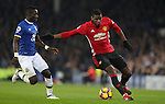 Paul Pogba of Manchester United and Idrissa Gueye of Everton during the Premier League match at Goodison Park, Liverpool. Picture date: December 4th, 2016.Photo credit should read: Lynne Cameron/Sportimage
