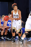 28 November 2010:  FIU player Rakia Rodgers (14) handles the ball in the first half as the FIU Golden Panthers defeated the Indiana State Sycamores, 68-47, to win the 16th annual FIU Thanksgiving Classic at the U.S. Century Bank Arena in Miami, Florida.