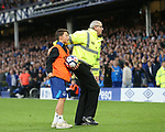 A young ball boy is protected by a steward following crowd violence during the Europa League Qualifying Play Offs 1st Leg match at Goodison Park Stadium, Liverpool. Picture date: August 17th 2017. Picture credit should read: David Klein/Sportimage