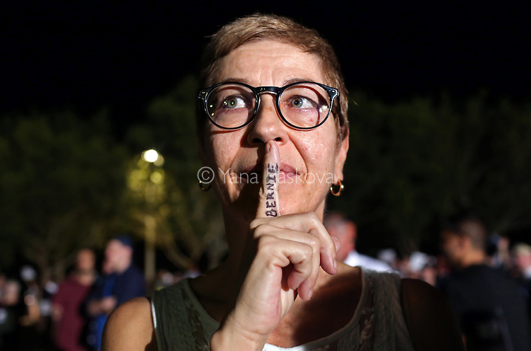 Pam Becker, 51, poses for a portrait with the name of U.S. Presidential candidate Bernie Sanders (I-VT) written on her finger at a rally for candidate Donald Trump (R-NY) at Sunset Cove Amphitheater in Boca Raton, FL, on March 13, 2016. Becker, a Democrat, says of her attendance to a Trump rally: &quot;It's hard to argue against someone if I don't have the knowledge. Simply calling people names is not an argument.&quot; <br /> <br /> Photo by: Yana Paskova
