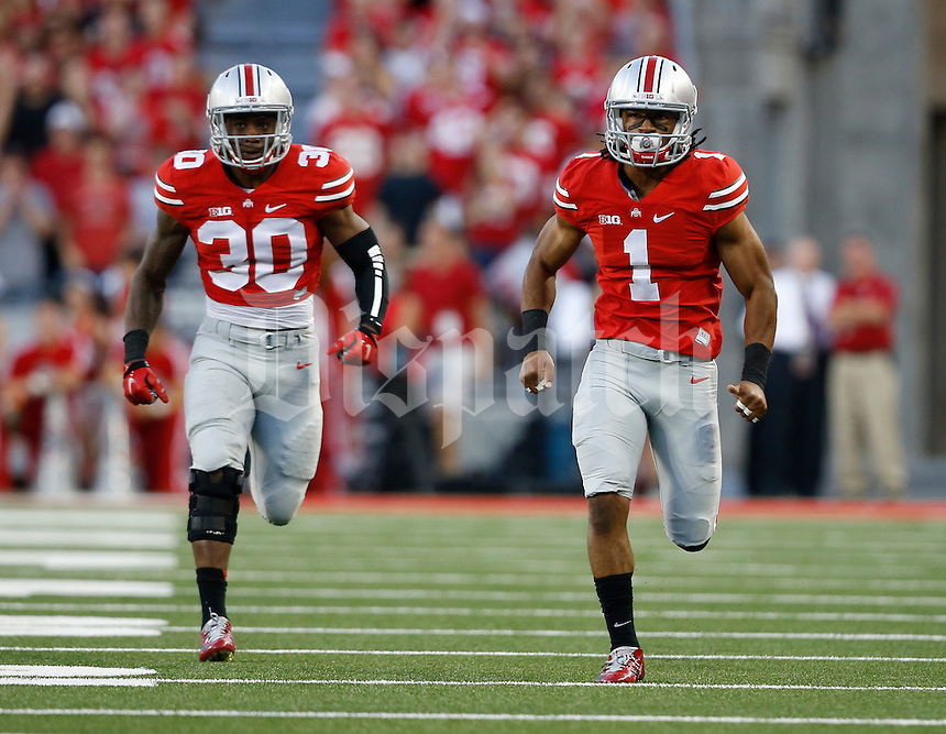 Ohio State Buckeyes safety Erick Smith (1) and Ohio State Buckeyes linebacker Devan Bogard (30) run upfield to cover a kickoff during the NCAA football game against the Cincinnati Bearcats at Ohio Stadium in Columbus on Sept. 27, 2014. (Adam Cairns / The Columbus Dispatch)