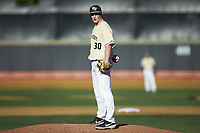 Wake Forest Demon Deacons relief pitcher Andrew Rust (30) looks to his catcher for the sign against the Quinnipiac Bobcats at David F. Couch Ballpark on February 24, 2019 in  Winston-Salem, North Carolina.  The Demon Deacons defeated the Bobcats 15-5.  (Brian Westerholt/Four Seam Images)