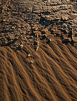 Sand and cracked mud at Death Valley.