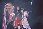 Vince Neil, Mick Mars & Nikki Sixx of Motley Crue at Hartford Civic Center Oct 1985.