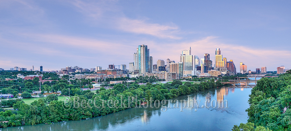Captured this aerial pano image of the Austin skyline downtown over Lady Bird Lake at sunset.  This image includes all the way to Texas Capital to UT Tower. This cityscape image was a fleeting capture only got these great sky with pink colors for a moment. We loved this view looking down Lady Bird Lake with all the high rise buildings along the shore line and the Lamar, Pfluger, along with First and Congress. We also found out that they had closed down the lake due to flooding upstream while we were shooting, just another day in TexasWe were able to capture this high quality aerial image because we use a full frame camera on our drone for out still photographs so we can get the best image which can be printed easlity as a 20 x 60 or larger size without loss of resolution.​