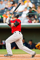 Brett Carroll #25 of the Pawtucket Red Sox follows through on his swing against the Charlotte Knights at Knights Stadium on August 11, 2011 in Fort Mill, South Carolina.  The Red Sox defeated the Knights 3-2.   (Brian Westerholt / Four Seam Images)