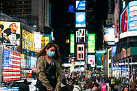 NEW YORK, NY - MARCH 13: People wears face masks as they walk in Times Square in New York on March 13, 2020. in New York City. President Donald Trump declared a national state of emergency on Friday, More than 1,600 people have tested positive for the new coronavirus and 41 have died since the first case was reported in January. <br /> (Photo by Eduardo Munoz/ VIEWpress via Getty Images)