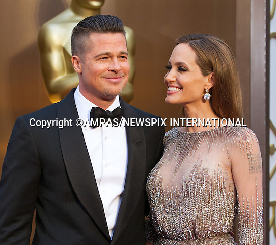20.09.2016: BRANGELINA NO MORE - ANGELINA JOLIE FILES FOR DIVORCE FROM BRAD PITT<br /> Jolie filed for divorce from Pitt for 'the health of her family', two years after the couple wed at their French estate Chateau Miraval.The actress filed papers on Monday citing irreconcilable differences as the reason for the split and asking for physical custody of the couple's six children - Maddox, age 15; Pax, aged 12; Zahara, aged 11; Shiloh, aged 10; and twins Vivienne and Knox, aged eight.<br /> <br /> Brad Pitt and Angelina Jolie<br /> 86TH OSCARS<br /> The Annual Academy Awards at the Dolby Theatre, Hollywood, Los Angeles<br /> Mandatory Photo Credit: &copy;Dias/Newspix International<br /> <br /> **ALL FEES PAYABLE TO: &quot;NEWSPIX INTERNATIONAL&quot;**<br /> <br /> PHOTO CREDIT MANDATORY!!: NEWSPIX INTERNATIONAL(Failure to credit will incur a surcharge of 100% of reproduction fees)<br /> <br /> IMMEDIATE CONFIRMATION OF USAGE REQUIRED:<br /> Newspix International, 31 Chinnery Hill, Bishop's Stortford, ENGLAND CM23 3PS<br /> Tel:+441279 324672  ; Fax: +441279656877<br /> Mobile:  0777568 1153<br /> e-mail: info@newspixinternational.co.uk