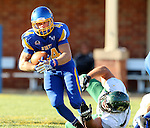 BROOKINGS, SD - SEPTEMBER 6:  Brady Mengarelli #44 from South Dakota State University slips the tackle of a defender from Cal Poly in the first half of their game Saturday evening at Coughlin Alumni Stadium in Brookings.(Photo/Dave Eggen/Inertia)