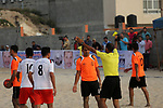 Palestinian Shabab Khan Younis players and al-Jalaa players compete for ball during the beach soccer (football) final match, in Gaza city on July 12, 2017. Photo by Mohammed Asad