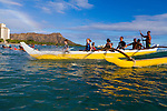 Outrigger Canoe rides are one of many attractions for tourists on Waikiki Beach in Honolulu, HI.  Waikiki is one of the only places where anyone can ride waves in traditional outrigger canoes.