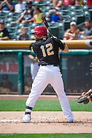 Collin Cowgill (12) of the Salt Lake Bees at bat against the Omaha Storm Chasers in Pacific Coast League action at Smith's Ballpark on August 16, 2015 in Salt Lake City, Utah. Cowgill was in Salt Lake on a rehab assignment from the Los Angeles Angels of Anaheim.  Omaha defeated Salt Lake 11-4. (Stephen Smith/Four Seam Images)