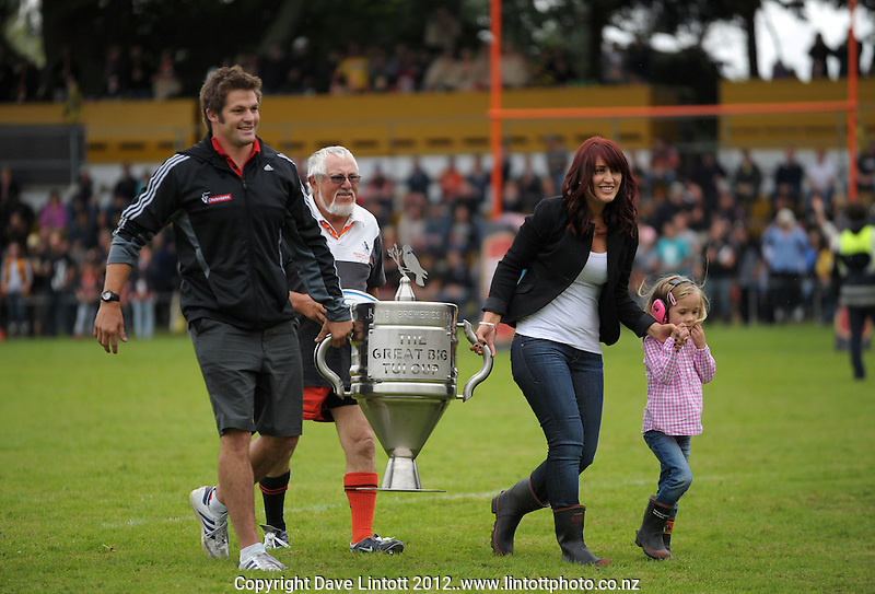 Richie McCaw arrives with the Great Big Tui Cup during the Super 15 rugby pre-season match between Hurricanes v Crusaders at Mangatainoka RFC, Mangatainoka, Wairarapa, New Zealand on Saturday, 11 February 2012. Photo: Dave Lintott / lintottphoto.co.nz