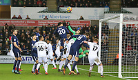 Goalkeeper Lukasz Fabianski of Swansea City  punches clear of Dele Alli of Spurs during the Premier League match between Swansea City and Tottenham Hotspur at the Liberty Stadium, Swansea, Wales on 2 January 2018. Photo by Mark Hawkins / PRiME Media Images.