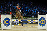 Team Blaze: Rider Daniel Deusser of Germany and Jockey Neil Callan of Ireland compete during the Hong Kong Jockey Club Race of the Riders, part of the Longines Masters of Hong Kong on 10 February 2017 at the Asia World Expo in Hong Kong, China. Photo by Marcio Rodrigo Machado / Power Sport Images