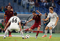 Calcio, Champions League, Gruppo E: Roma vs CSKA Mosca. Roma, stadio Olimpico, 17 settembre 2014.<br /> Roma midfielder Miralem Pjanic, of Bosnia, center, is challenged by CSKA Moskva midfielder Bebras Natcho, of Israel, left, and forward Kirill Panchenko during the Group E Champions League football match between AS Roma and CSKA Moskva at Rome's Olympic stadium, 17 September 2014.<br /> UPDATE IMAGES PRESS/Riccardo De Luca