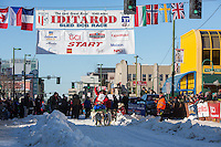 Alan Eischens and team leave the ceremonial start line with an Iditarider and handler at 4th Avenue and D street in downtown Anchorage, Alaska on Saturday March 4th during the 2017 Iditarod race. Photo © 2017 by Brendan Smith/SchultzPhoto.com.
