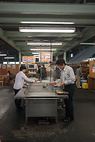 At the end of the lunch rush, customers heat and season noodles at Kirin Udon.